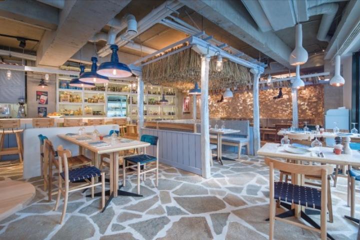 Kuzina traditional greek restaurant in Bucharest by Corvin Cristian & Serban Rosca